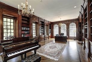 Traditional Home Office with Hardwood floors, Arched window, Chandelier, Built-in bookshelf