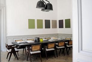 Contemporary Dining Room with Laminate floors, Crown molding, Standard height, Wainscotting