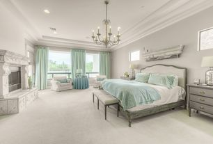 Traditional Master Bedroom with stone fireplace, Carpet, Chandelier, Crown molding