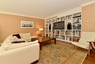 Contemporary Living Room with Hardwood floors, Built-in bookshelf, Crown molding