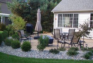 Traditional Patio with Outdoor kitchen, Fire pit, exterior stone floors, Casement