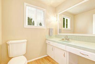 Traditional Powder Room with Hardwood floors, Sample of lush sea grass - 3x6 glass subway tile, Built-in bookshelf