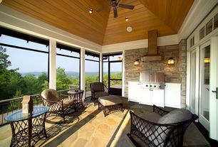 Traditional Porch with exterior stone floors, Transom window, French doors, Outdoor kitchen, Screened porch