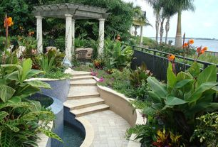 Tropical Landscape/Yard with exterior tile floors, Pathway, Raised beds, exterior herringbone tile floors, Fence, Trellis