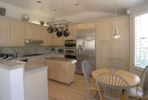 Traditional Kitchen with Bamboo floors, Raised panel, Kitchen island, U-shaped, Simple Granite, Simple granite counters