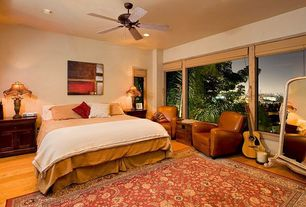 Traditional Guest Bedroom with picture window, Ceiling fan, Laminate floors, Standard height, can lights