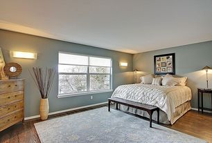 Modern Guest Bedroom with Wall sconce, Carpet, Hardwood floors