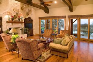 Craftsman Living Room with Laminate floors, Fireplace, Exposed beam, stone fireplace, can lights, Standard height, Carpet