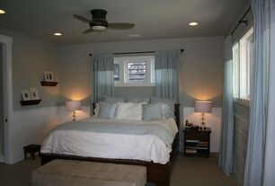 Modern Guest Bedroom with Wainscoting, Wainscotting, Concrete floors, Casement, can lights, Draw draperies, specialty window