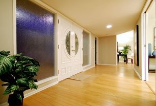 Traditional Entryway with Glass panel door, can lights, Standard height, Bamboo floors