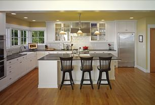 Traditional Kitchen with Paint, Hardwood floors, Farmhouse sink, Soapstone counters, flat door, Absolute black, Wall Hood