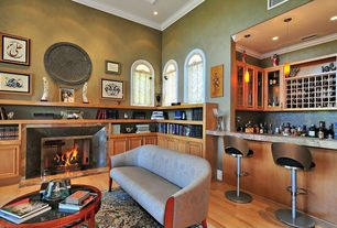 Eclectic Bar with Arched window, Pendant light, Laminate floors, Fireplace, High ceiling, metal fireplace, can lights