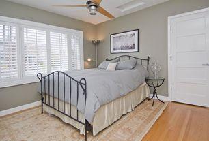 Modern Guest Bedroom with specialty door, Carpet, Laminate floors, Ceiling fan