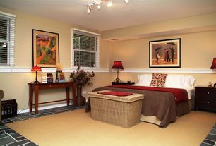 Eclectic Guest Bedroom with Chair rail, Carpet, terracotta tile floors