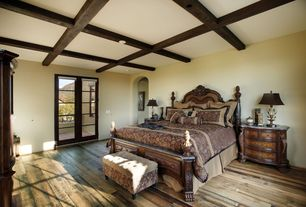 Traditional Guest Bedroom with French doors, Standard height, Hardwood floors, Box ceiling, Exposed beam