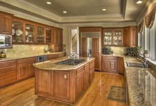 Traditional Kitchen with single bowl drop-in sink, Kitchen island, large gas range, electric range, Framed Partial Panel