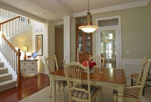 Country Dining Room with Carpet, Laminate floors, Crown molding, can lights, Transom window, Glass panel door, Wainscotting