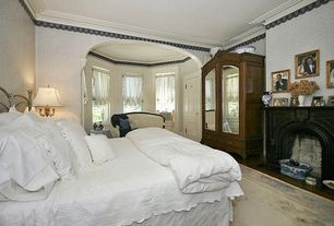 Traditional Master Bedroom with stone fireplace, Standard height, specialty door, Crown molding, interior wallpaper