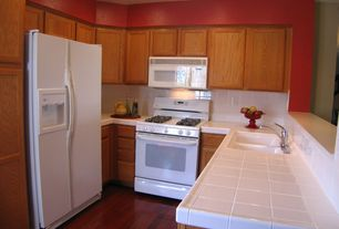 Traditional Kitchen with High ceiling, Undermount sink, Flat panel cabinets, Laminate floors, Large Ceramic Tile, Flush