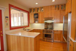 Cottage Kitchen with Flush, Undermount sink, Large Ceramic Tile, Flat panel cabinets, U-shaped, Glass panel, Hardwood floors