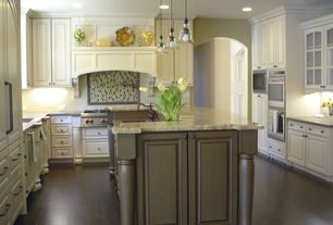 Traditional Kitchen with can lights, Farmhouse sink, Glass panel, double wall oven, Ceramic Tile, Custom hood, Pendant light