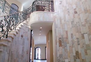 Contemporary Staircase with simple marble floors, Cathedral ceiling