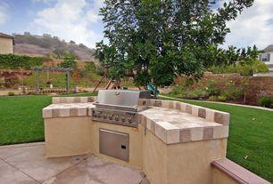 Mediterranean Patio with Arbor, exterior stone floors, Fence, Outdoor kitchen