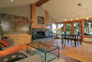 Craftsman Great Room with Built-in bookshelf, Carpet, Soleil nickel monorail pendant, stone fireplace, Laminate floors