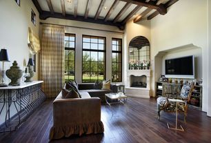 Eclectic Living Room with Exposed beam, Built-in bookshelf, High ceiling, Bamboo floors