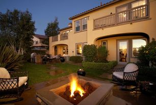 Mediterranean Patio with Fire pit, Outdoor kitchen, French doors