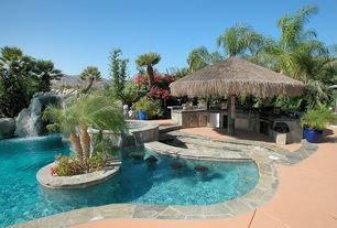 Tropical Swimming Pool with Pool with hot tub, exterior concrete tile floors, Outdoor kitchen, exterior tile floors