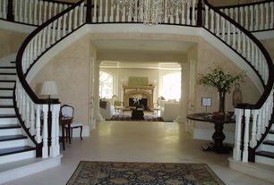 Traditional Staircase with Double staircase, interior wallpaper, Chandelier, High ceiling, Hardwood floors