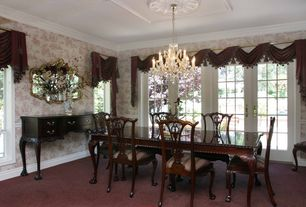Traditional Dining Room with French doors, Crown molding, interior wallpaper, Carpet, Chandelier, Chair rail