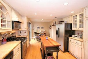 Country Kitchen with Kitchen island, Paint 1, can lights, full backsplash, Standard height, Framed Partial Panel, gas range