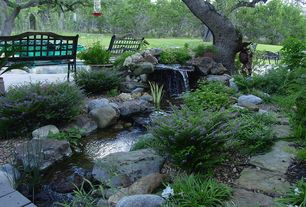 Traditional Landscape/Yard with Water feature, Pond, exterior tile floors, exterior stone floors, Naturalistic landscaping