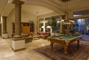 Eclectic Game Room with Concrete tile , Cathedral ceiling, Chandelier