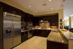 Contemporary Kitchen with Stainless steel appliances, Galley, European Cabinets, Pendant light, High ceiling, Undermount sink