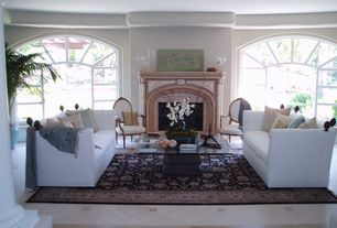 Traditional Living Room with Arched window, Columns, Cement fireplace