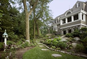 Traditional Landscape/Yard with double-hung window, picture window, Casement, exterior stone floors, Pathway