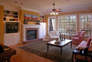 Traditional Living Room with Built-in bookshelf, Hardwood floors, flush light, Ceiling fan, Crown molding