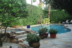 Rustic Swimming Pool with Pool with hot tub, Fence, exterior stone floors