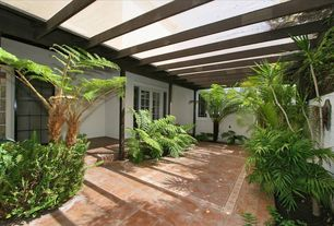 Mediterranean Landscape/Yard with exterior tile floors, Casement, exterior terracotta tile floors, French doors, Fence