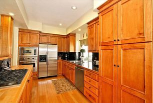 Craftsman Kitchen with Undermount sink, Stainless steel counters, wall oven, Flush, Flat panel cabinets, dishwasher, Galley