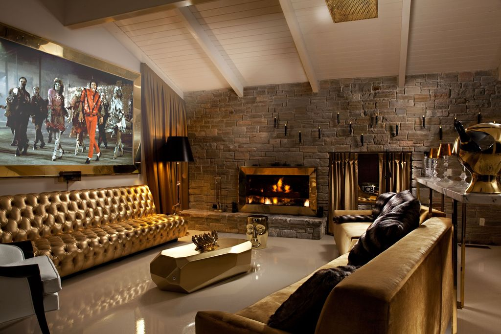 Eclectic Living Room with flush light, High ceiling, metal fireplace, Fireplace, Stacked stone fireplace, interior brick