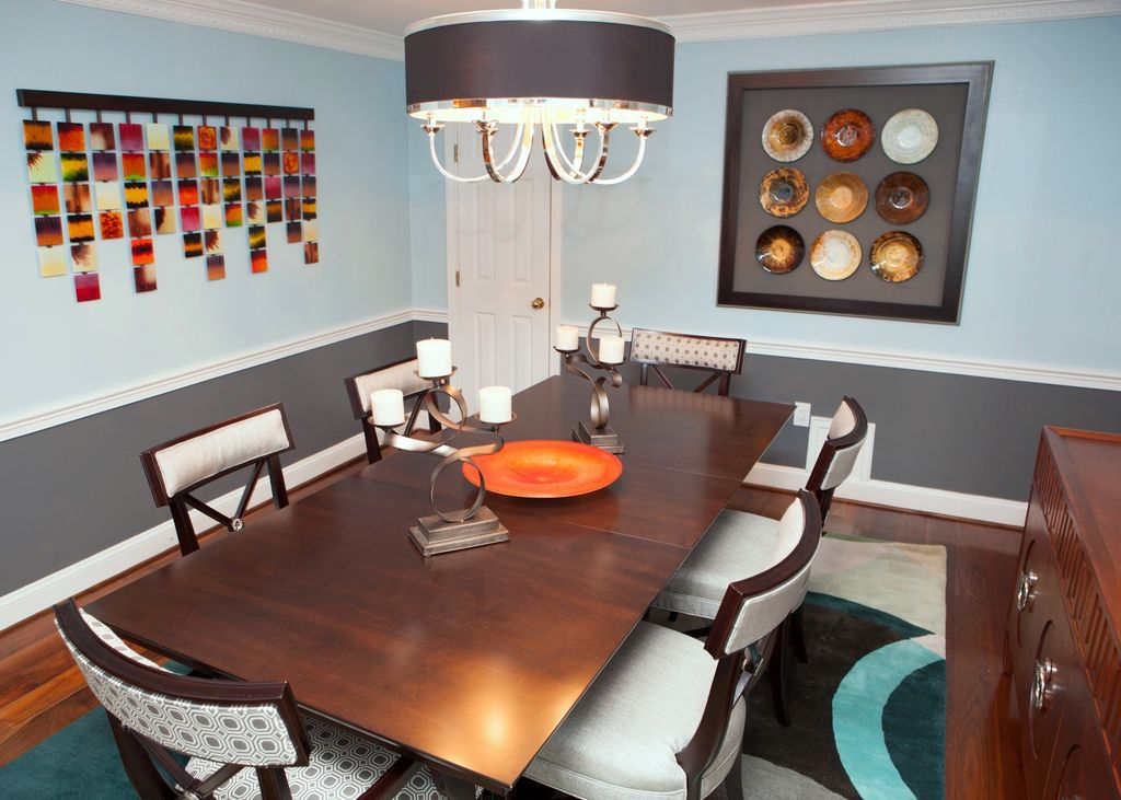 Contemporary Dining Room with Laminate floors, Standard height, Chair rail, Pendant light, six panel door, Crown molding