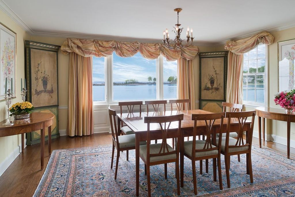 Traditional Dining Room with double-hung window, Crown molding, Chandelier, Standard height, picture window, Chair rail