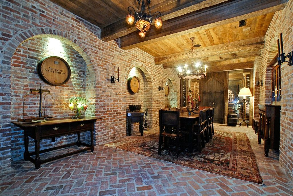 Mediterranean Wine Cellar with French doors, Wall sconce, Built-in bookshelf, interior brick, Exposed beam, High ceiling