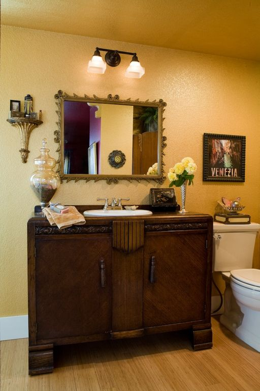 Eclectic Powder Room with Standard height, Inset cabinets, Wood counters, Bamboo floors, Flat panel cabinets, Powder room