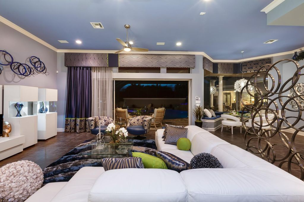 Modern Living Room with travertine tile floors, Ceiling fan, stone tile floors, Standard height, Crown molding, can lights