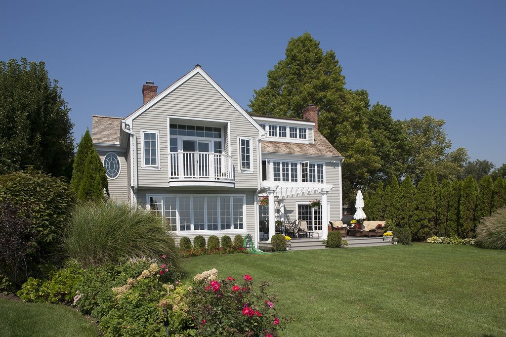 Traditional Landscape/Yard with Trellis, Casement, specialty window, French doors, Deck Railing